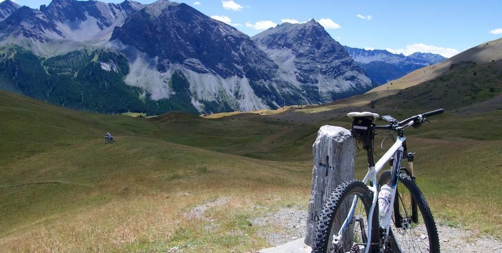 Bike on Border post.  Map readers below on Col de Bousson :)